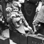 Black and white photo of World War Two evacuee girl at a railway station in Bodmin