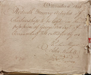 A photograph of the cover of a Redruth Brewery Article of Partnership dated 1806, sealed and signed by William Davey, Reuben Magor and John Michell.