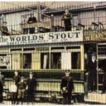 A hand coloured postcard showing Redruth Brewery advertising on a tram car in Camborne.