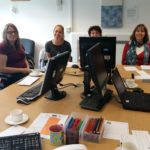 A photograph of Cornish Archives Network members receiving social media training