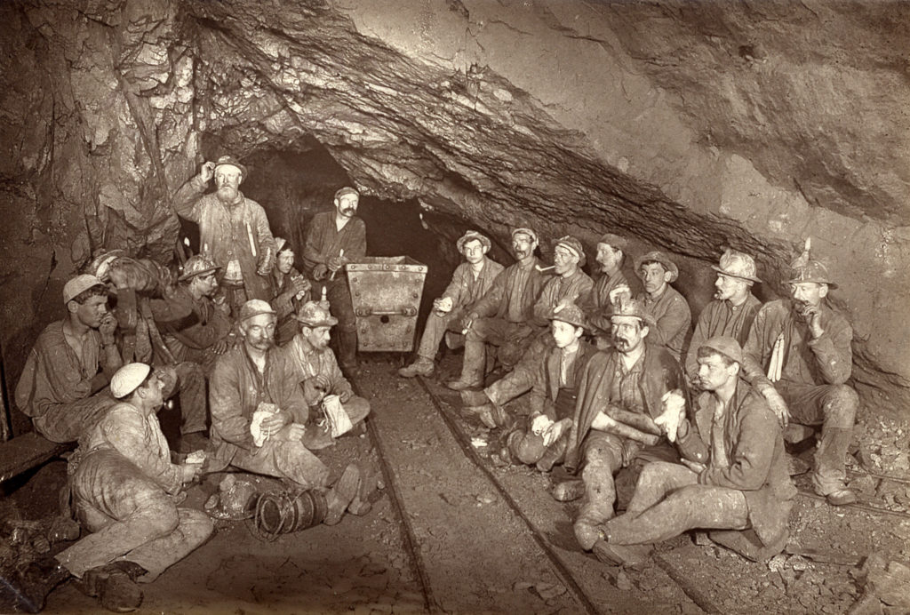 Photograph of miners eating lunch at East Pool Mine in the 1890s.
