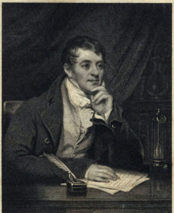 Print of Humphry Davy, chemist and inventor, at his desk, around 1829.