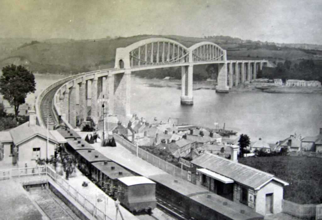Black and white photograph showing the Royal Albert Bridge in the 1860s.