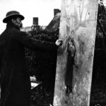 Black and white photograph of artist Stanhope Forbes painting, circa 1920.