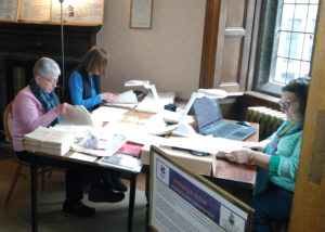 Photograph of volunteers working on documents at Lanhydrock.
