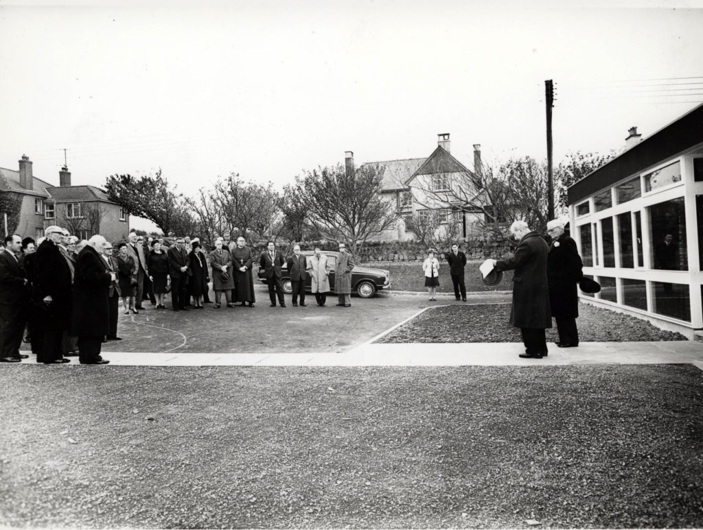 A black and white and colour photograph showing the opening of the Cornwall Record Office in 1964.
