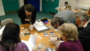 A photograph of Cornish Archives Network members at a photograph identification and care training day.
