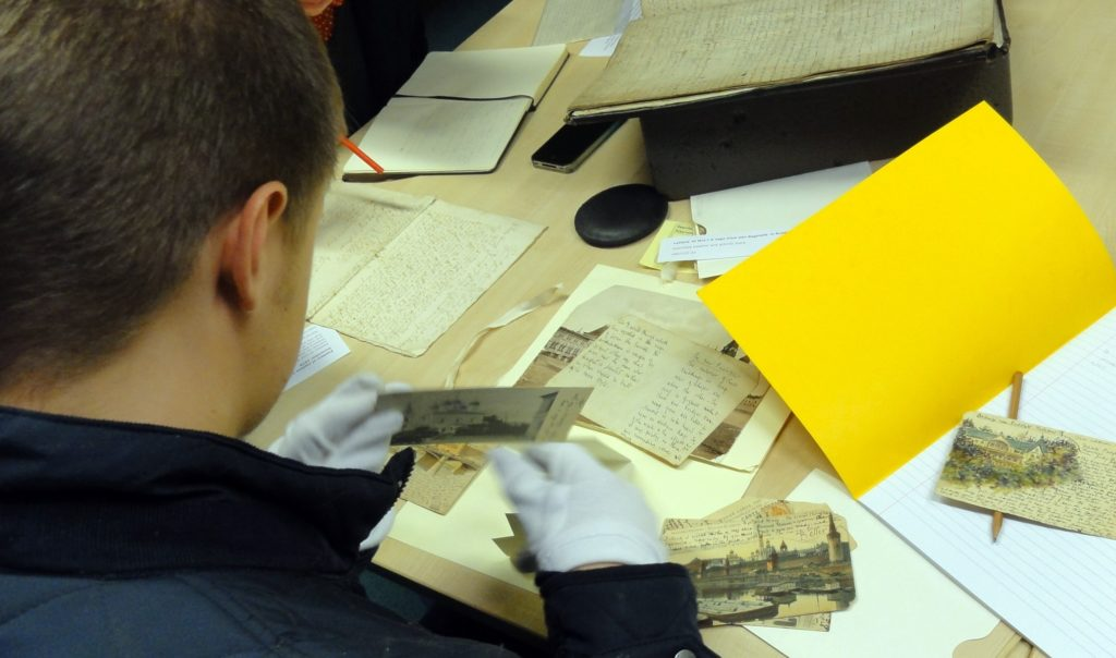 Photo of student looking at documents.