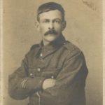 Photograph of Joe Hugh in army uniform, 1914.