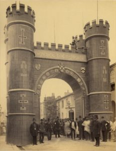 Sepia photo showing large wooden arch in Truro.