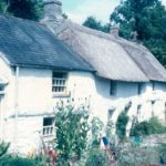 Photograph of thatched cottage.