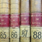 A close up photograph of the spines of some of the registers of wills at Kresen Kernow.