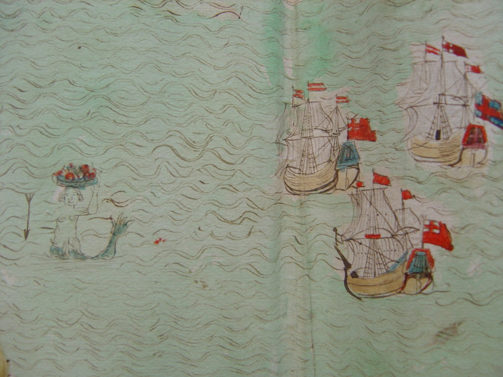 Coloured close up extract from hand drawn map showing ships and mermaid.