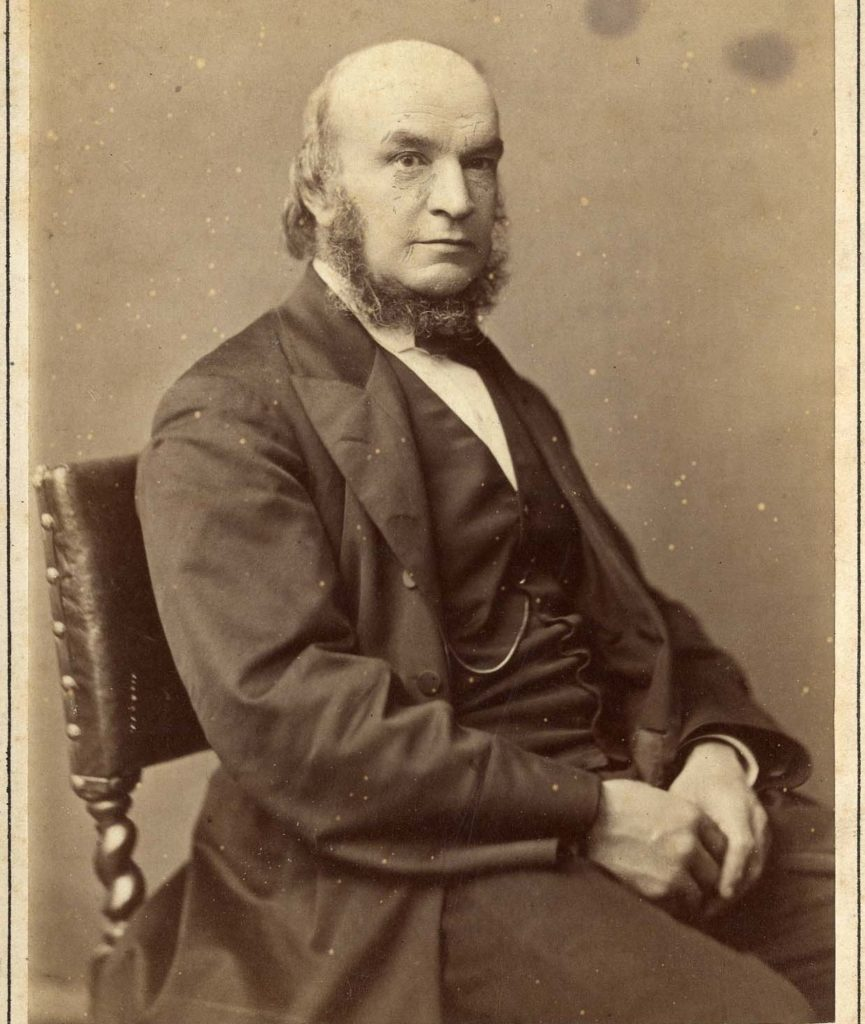 Sepia photograph of Cornish mathematician John Couch Adams, showing him seated.