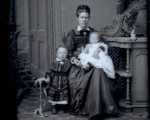 Victorian photographic portrait of lady with a child and a baby.