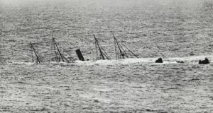 Photograph showing the wreck of the Mohegan submerged in water.
