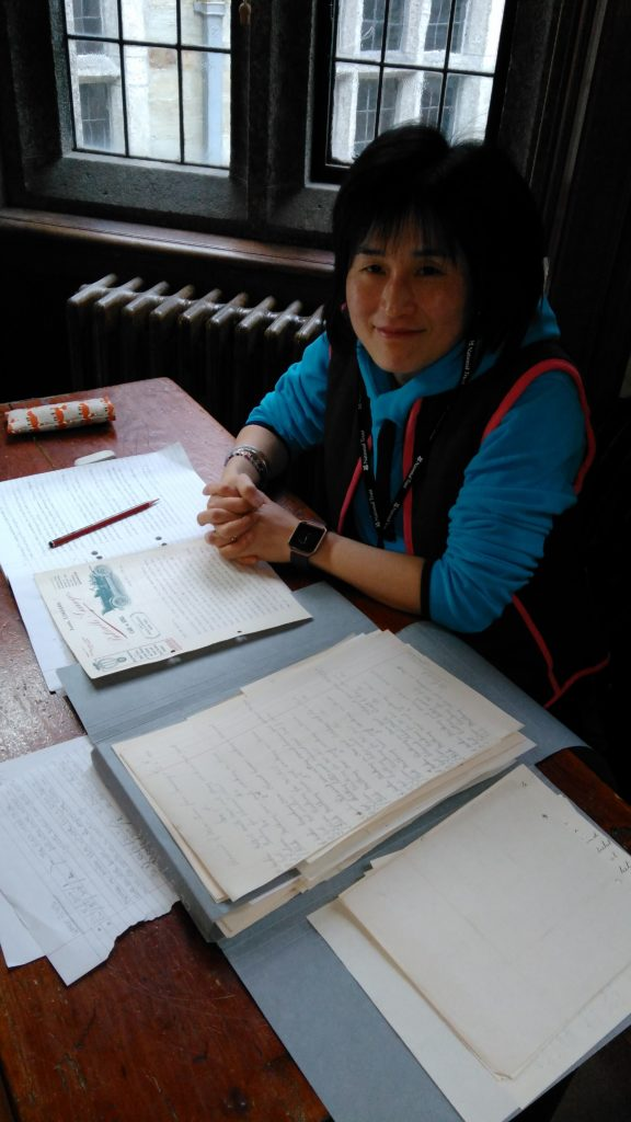 Photograph of volunteer with papers