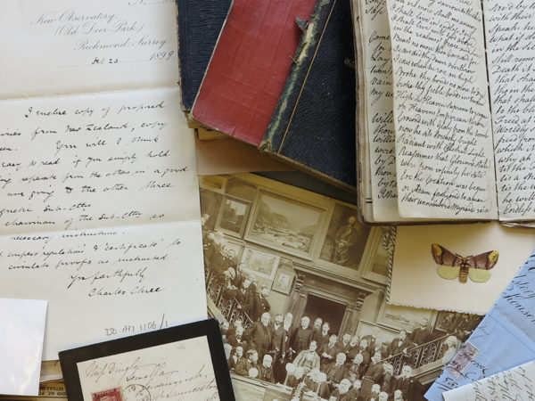 Colour photograph of variety of documents including letters and photos.
