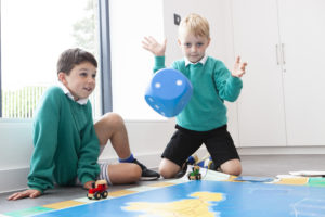 Photograph of two boys throwing a dice.