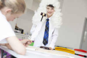 Photo of school child wearing judge's wig.