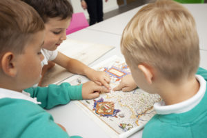 Photograph of children looking at historic map of Cornwall.