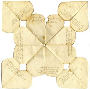 Scan of handwritten paper Valentine made up of eight hearts with handwritten verses.