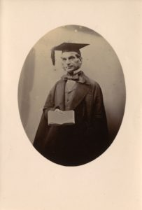 Photograph of John Couch Adams in cap and gown.