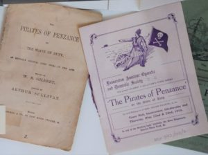 Photograph of printed pamphlets and programmes.