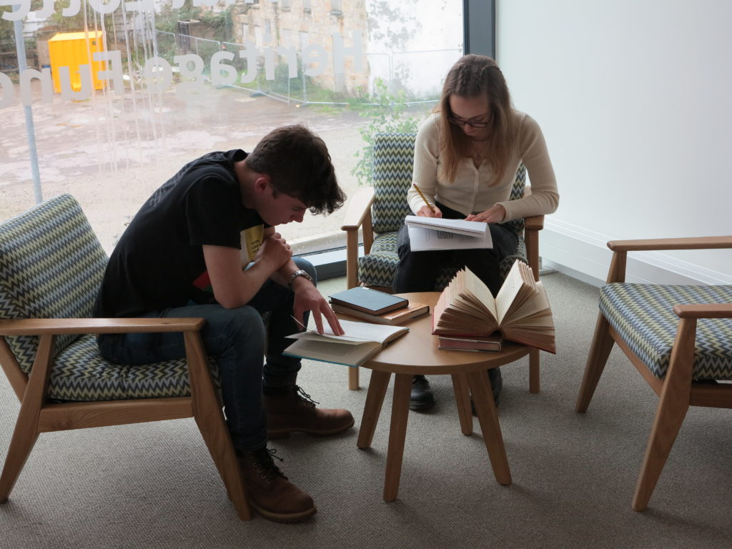 Photograph of two students in library