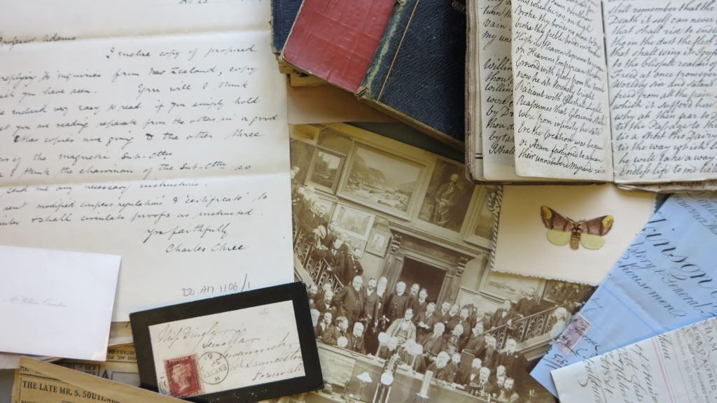 Colour photograph of collection of letters, diaries and photos.
