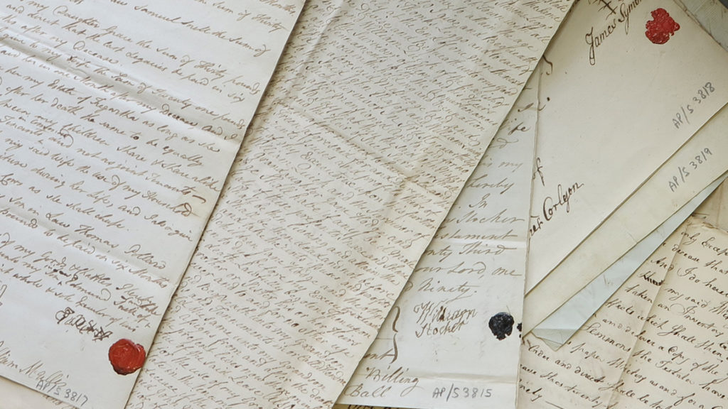Colour photograph of a pile of handwritten wills.