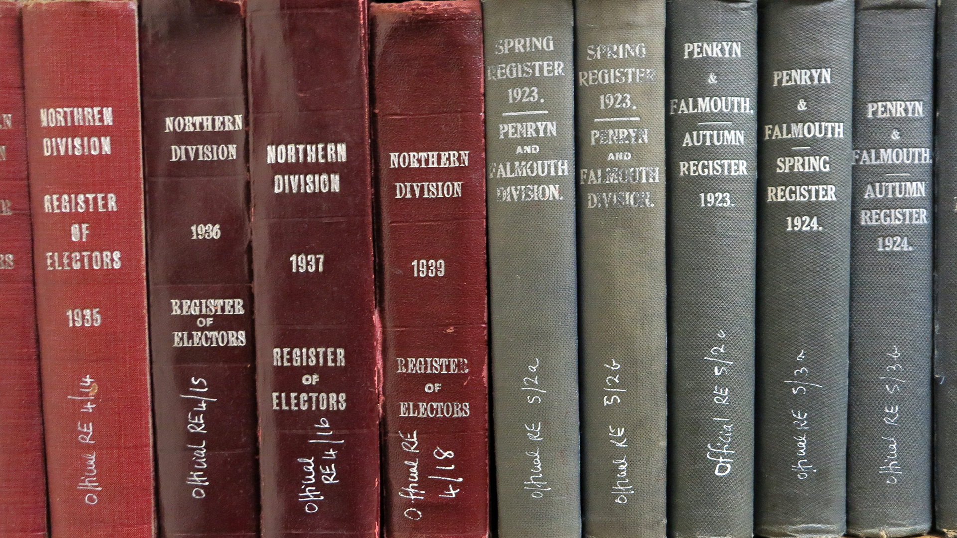 Colour photograph of book spines on a shelf.