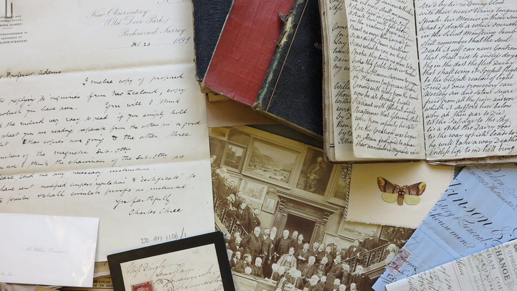 Colour photo montage of a range of different manuscripts including handwritten documents and a photograph.