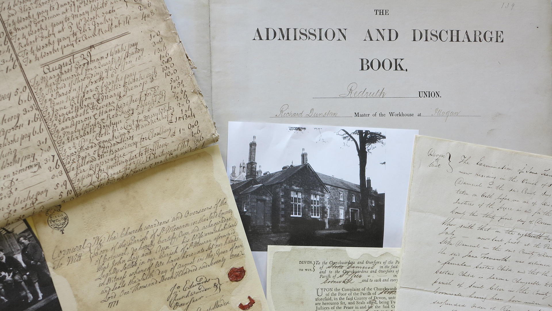 Colour photograph of a montage of documents including handwritten, printed and a photo.