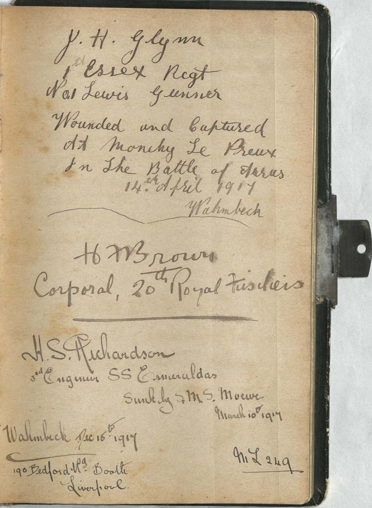 Image of an autograph book with signitures.