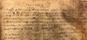 Photograph of extract from parish register on very badly damaged paper.