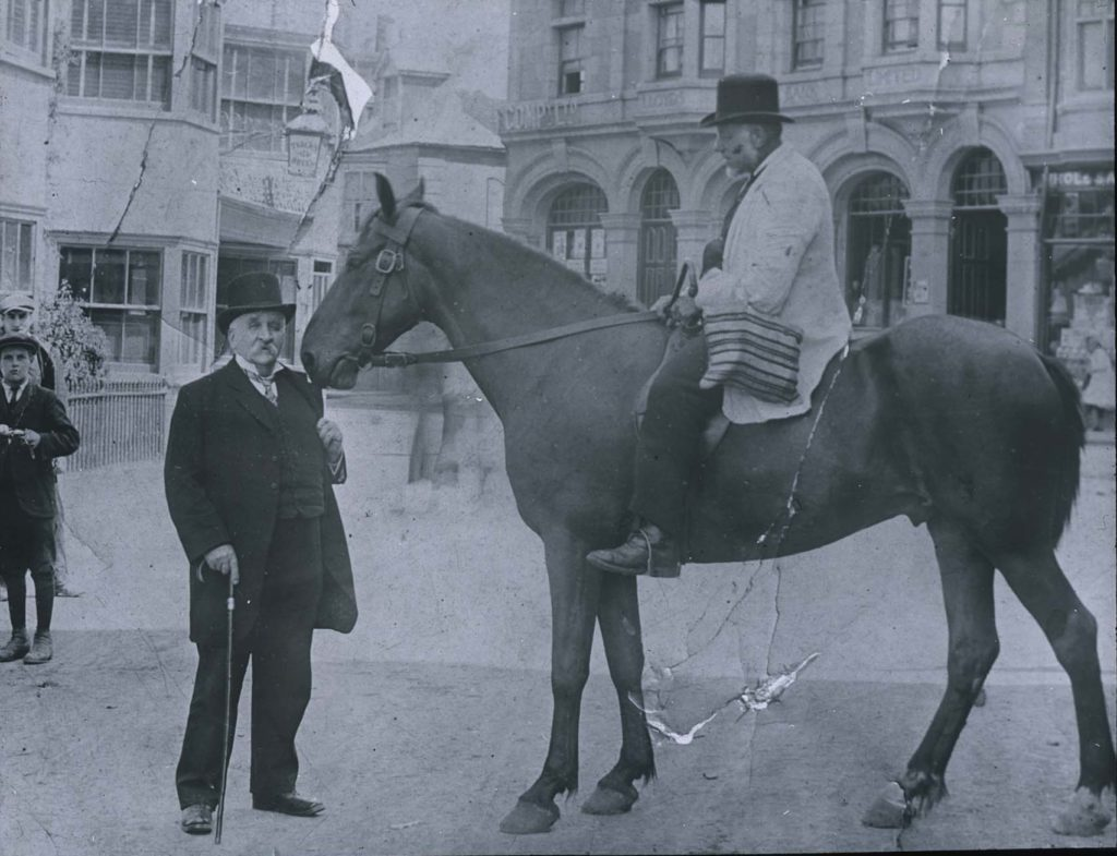 Photograph of a man on a horse.