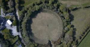 Aerial colour photograph showing a circular earth structure.