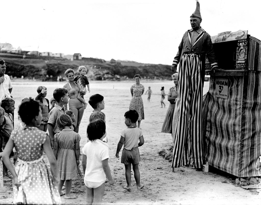 Photograph of children at a Punch & Judy show.