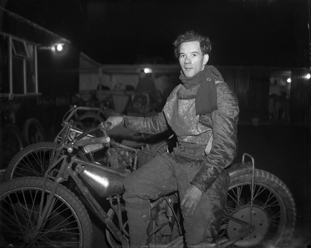 Photograph of speedway rider and motorbike.