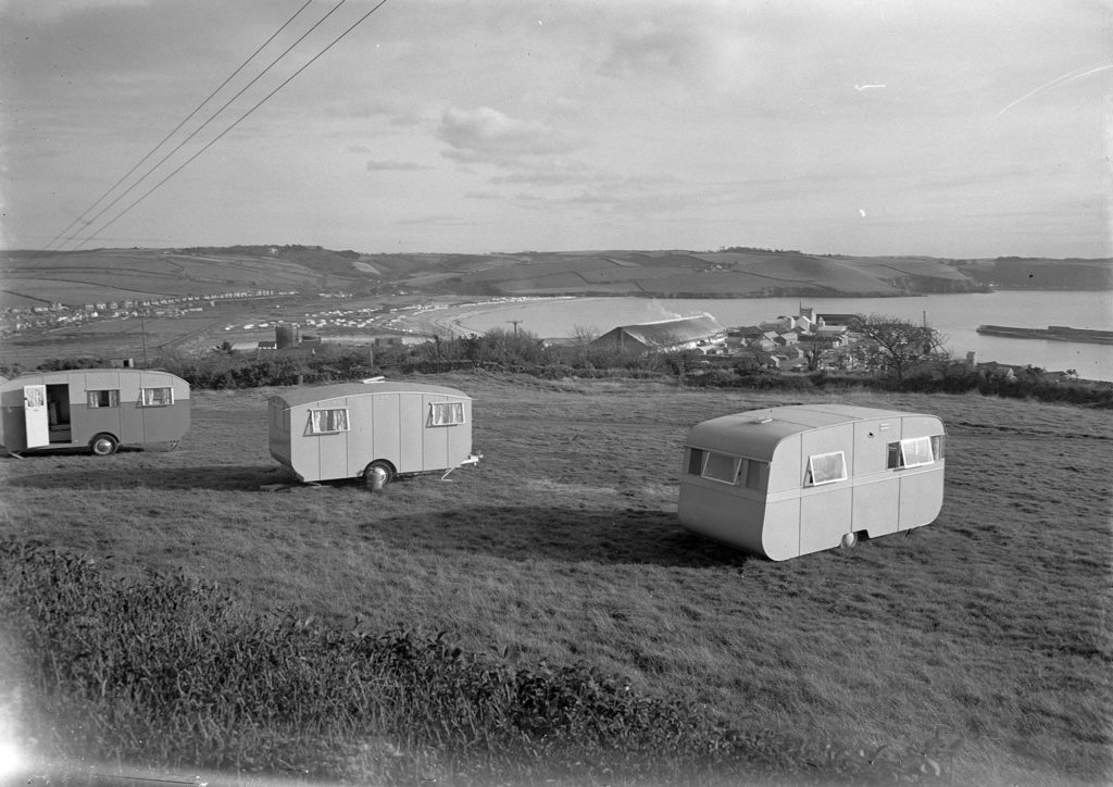 Photograph of caravans and beyond a seascape.