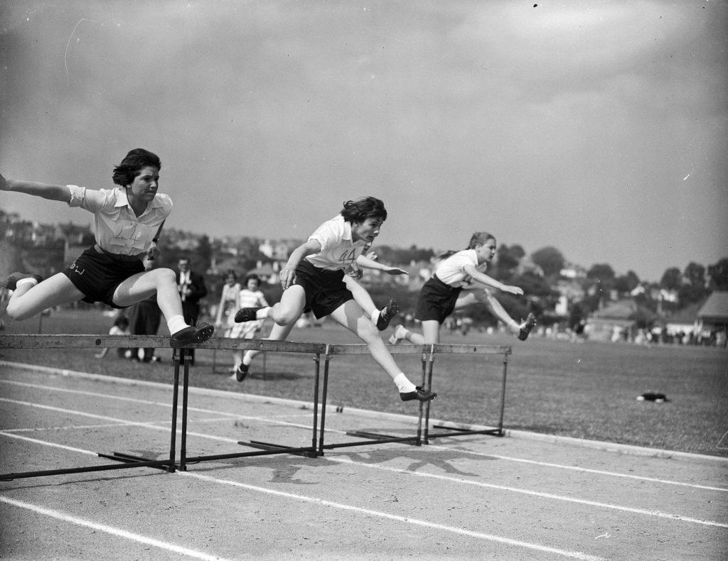 Photograph of a hurdles race.